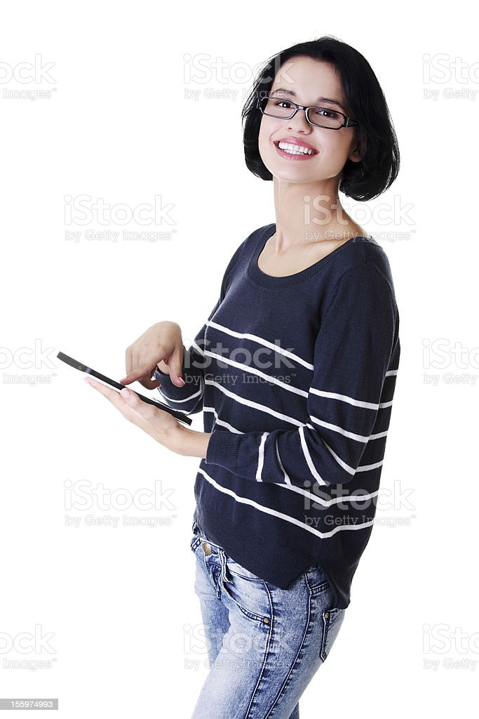 Young woman using digital tablet royalty-free stock photo