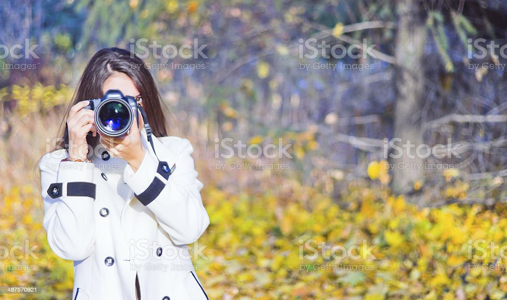 young woman using her camera to take photo stock photo