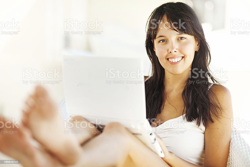young woman using her laptop computer royalty-free stock photo