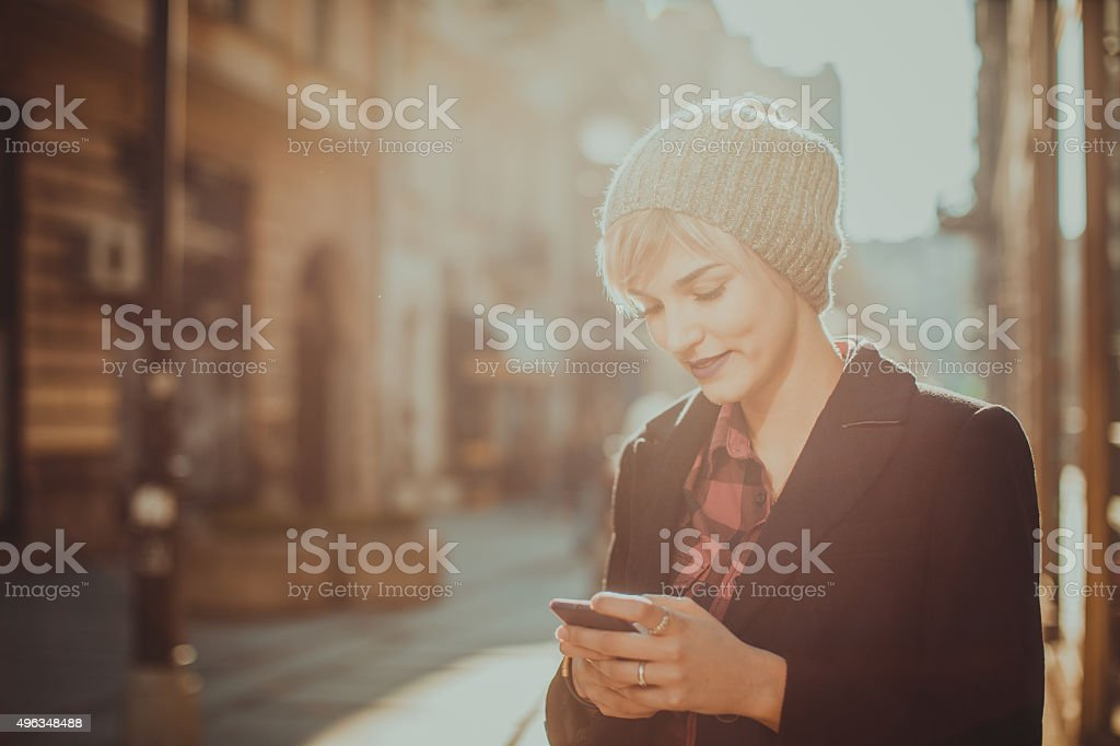 Young woman using her mobile phone stock photo