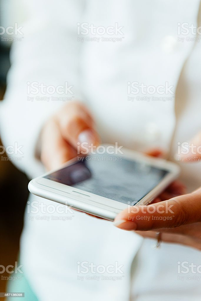 Young woman using her smartphone stock photo
