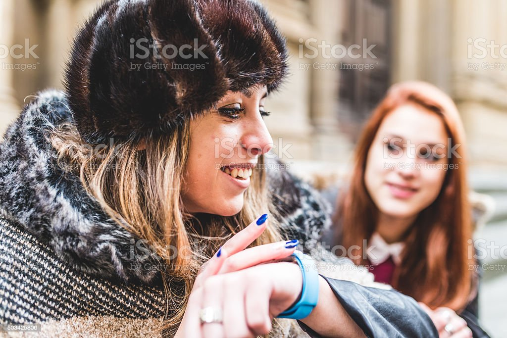 Young Woman Using Her Technological Watch stock photo