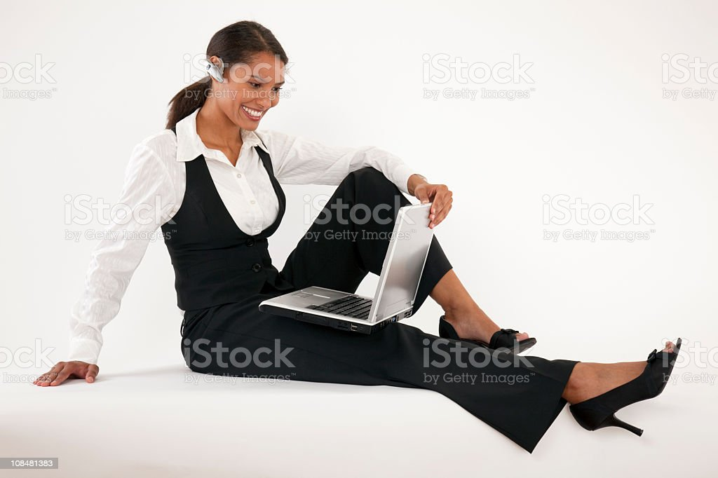 Young Woman Using Laptop and Blue Tooth royalty-free stock photo