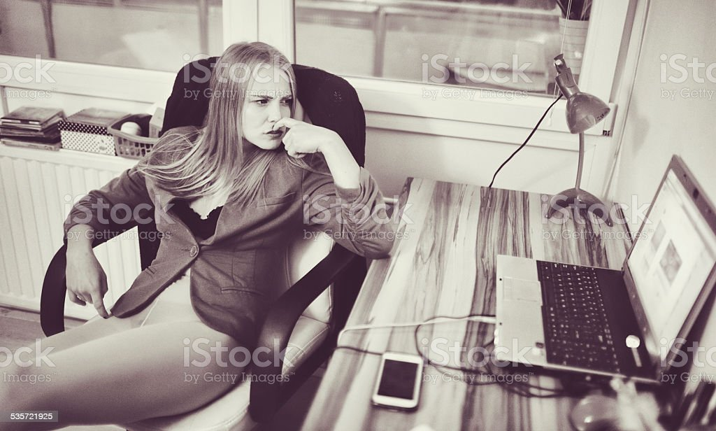 Young woman using laptop, social media, internet stock photo