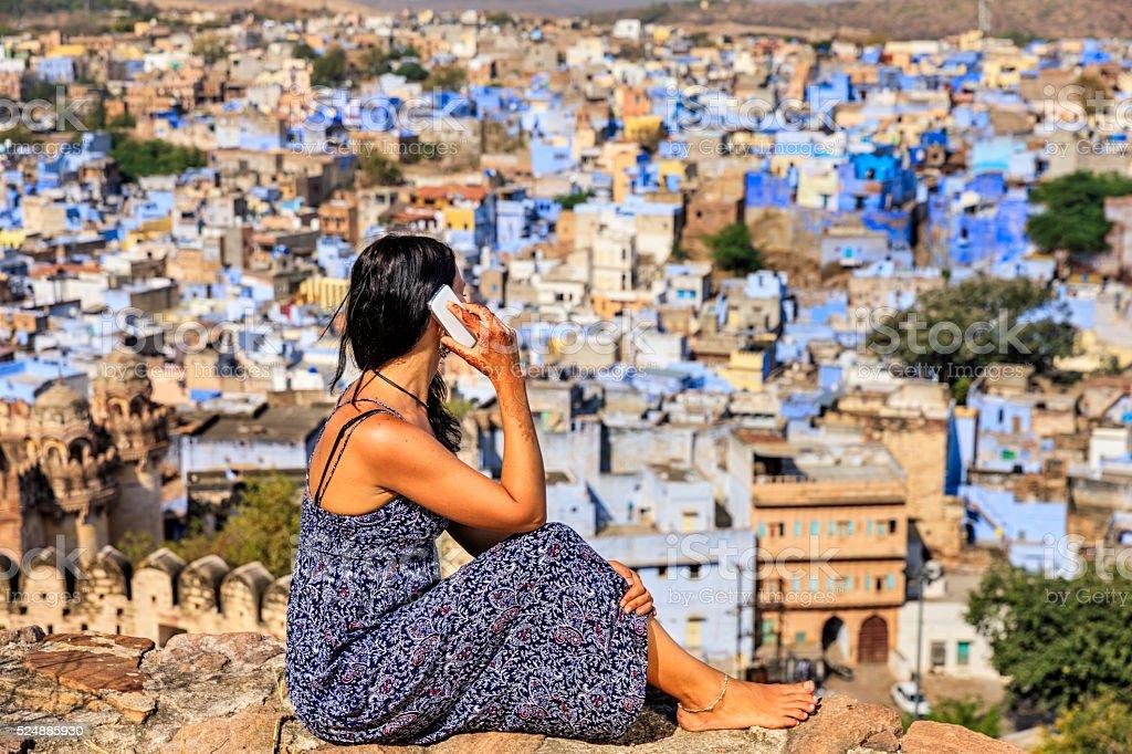 Young woman using mobile phone, Jodhpur, India stock photo