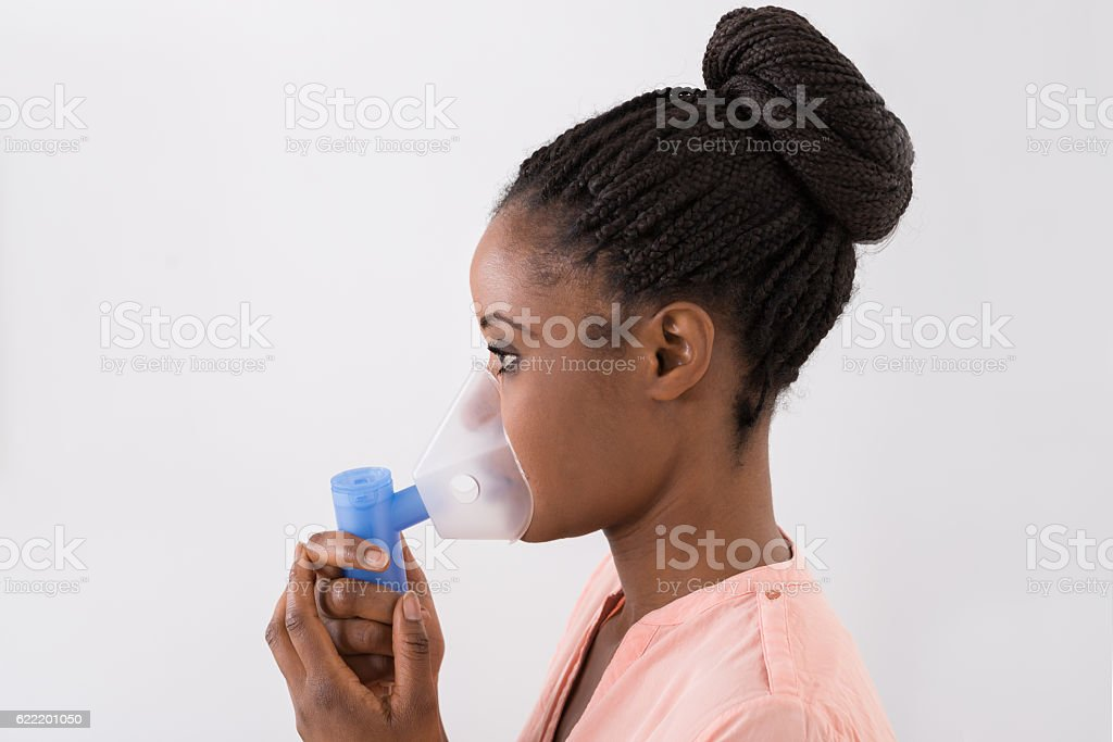 Young Woman Using Oxygen Mask stock photo