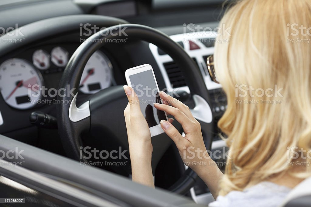 Young woman using smart phone royalty-free stock photo