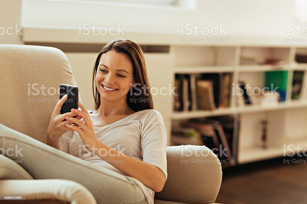 Young woman using smart phone stock photo