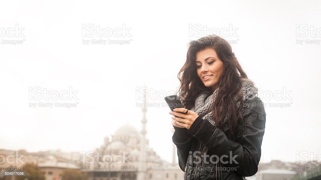 Young Woman Using Smartphone In Istanbul stock photo