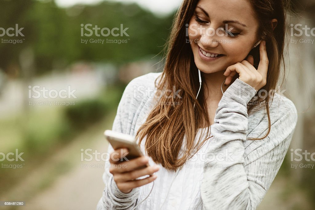 Young woman using smartphone stock photo
