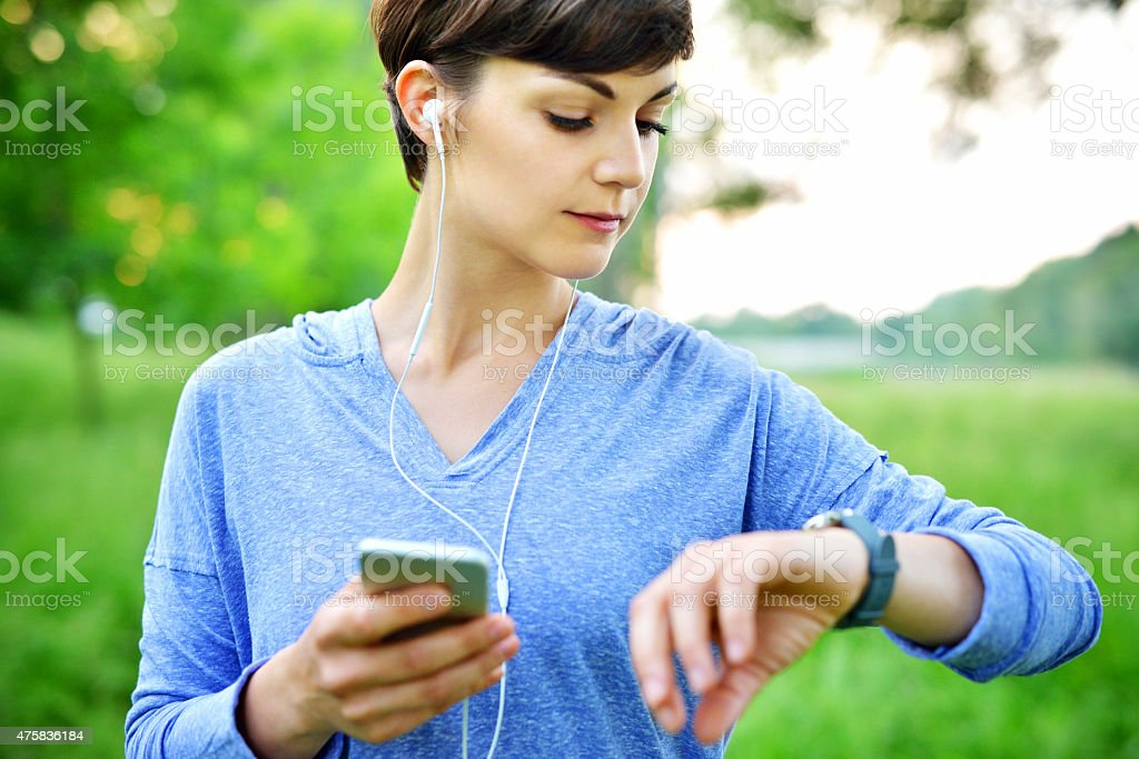 Young woman using smartwatch stock photo