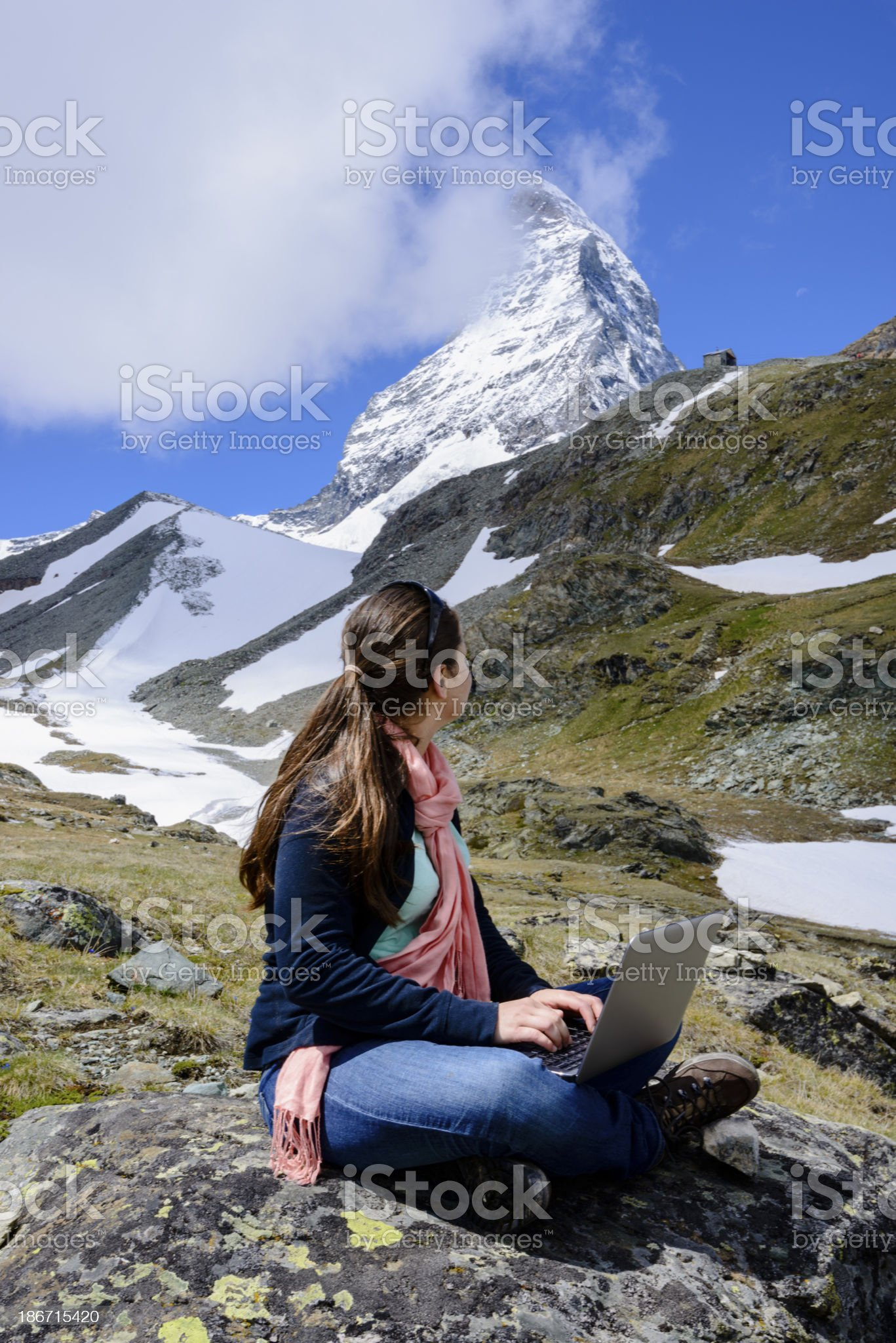 Young woman using social media in the mountains -XXXL royalty-free stock photo