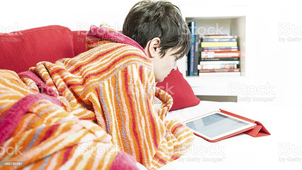 Young woman using tablet computer at home - Stock Image royalty-free stock photo