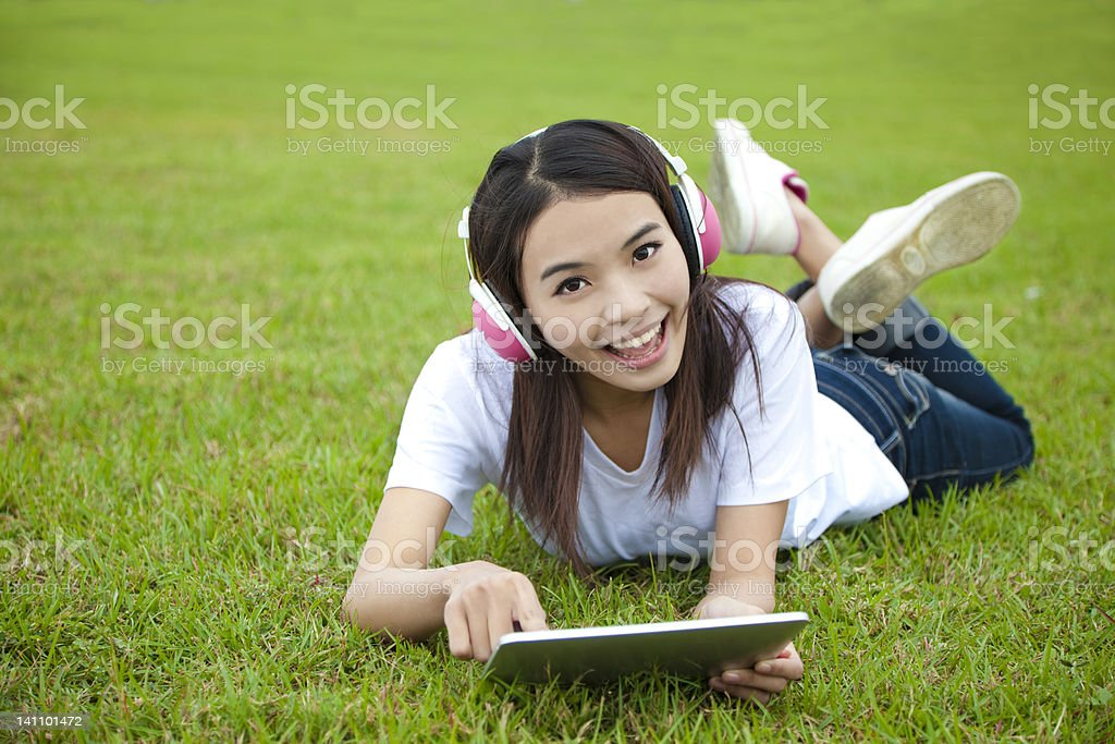 young woman using tablet pc on the grass royalty-free stock photo