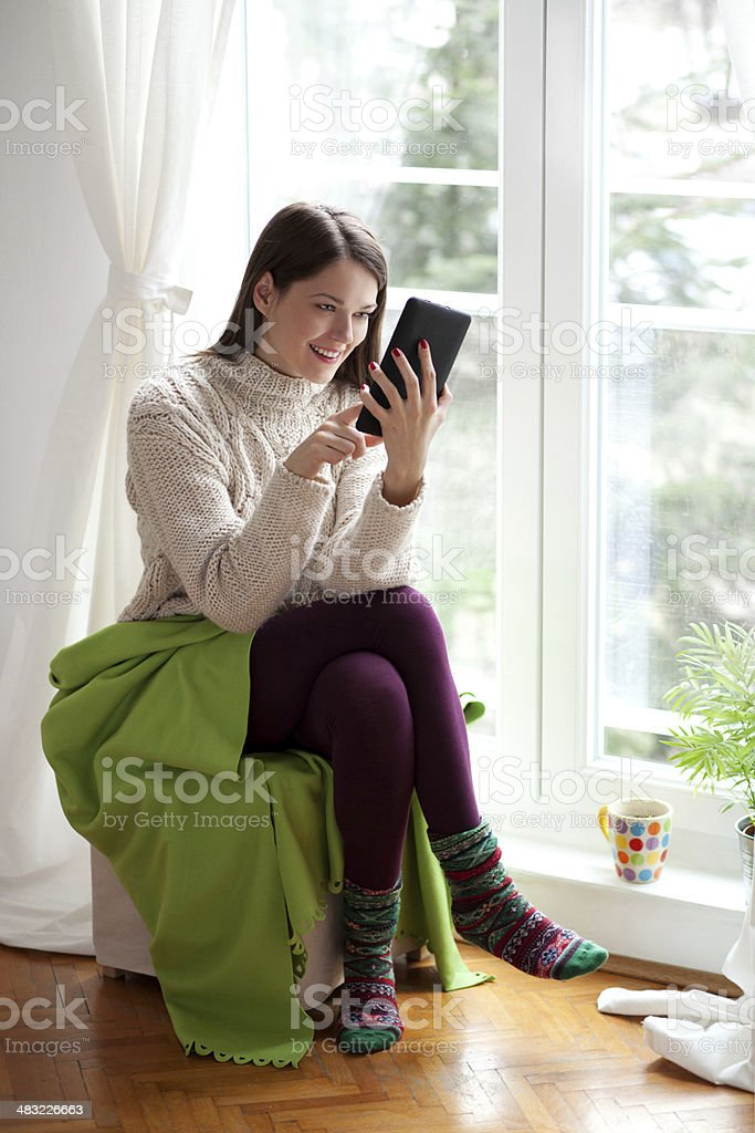 Young woman using tablet royalty-free stock photo