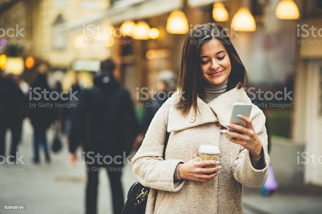 Young woman using the phone stock photo