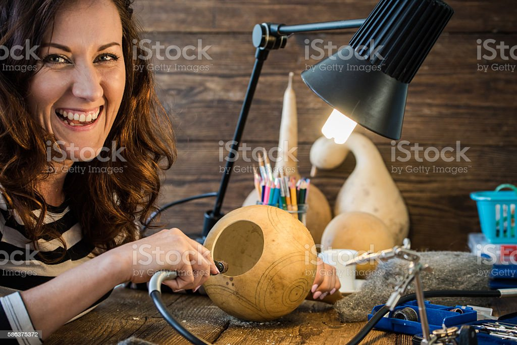 young woman using tools for creative craft stock photo