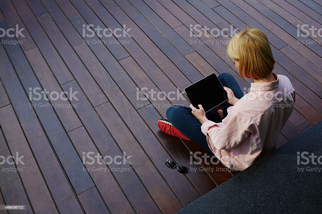 Young woman using touchscreen device in modern office stock photo