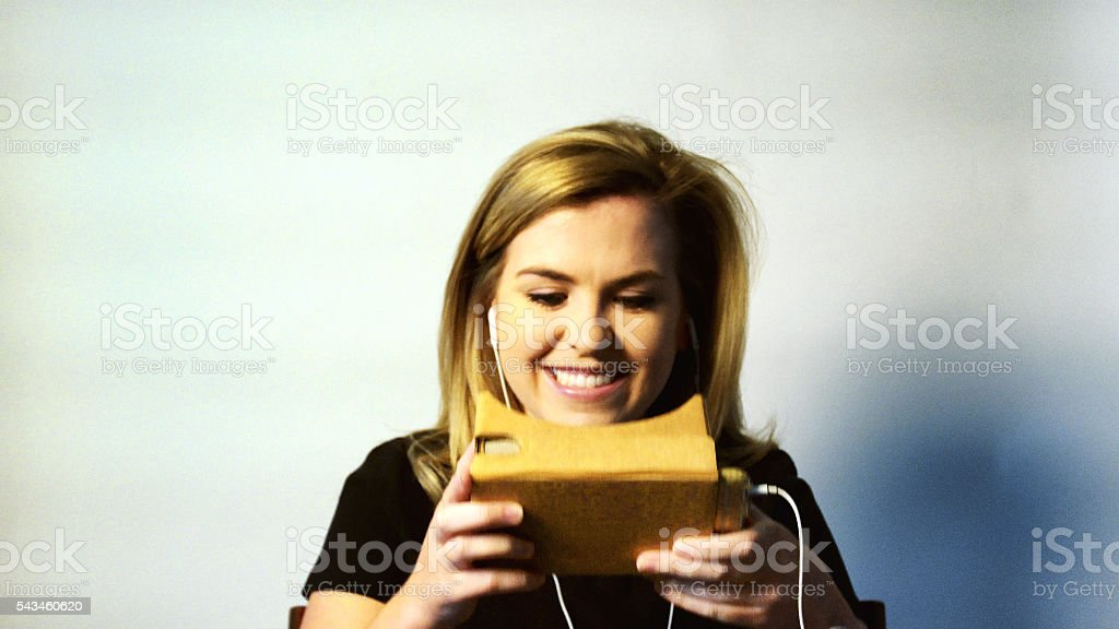 Young Woman Using Virtual Reality Device stock photo