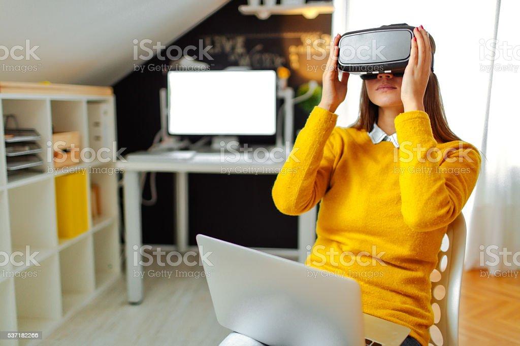 Young woman using virtual reality glasses stock photo