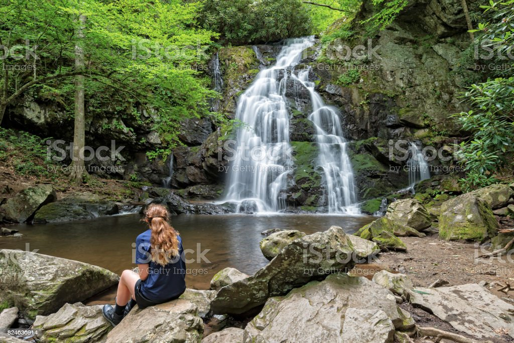 Young Woman Viewing Spruce Flats Falls In The Smoky Mountains stock photo