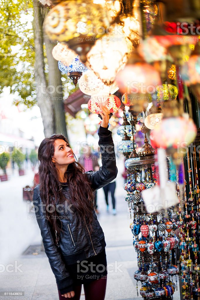 Young Woman Viewing Street Market Goods stock photo