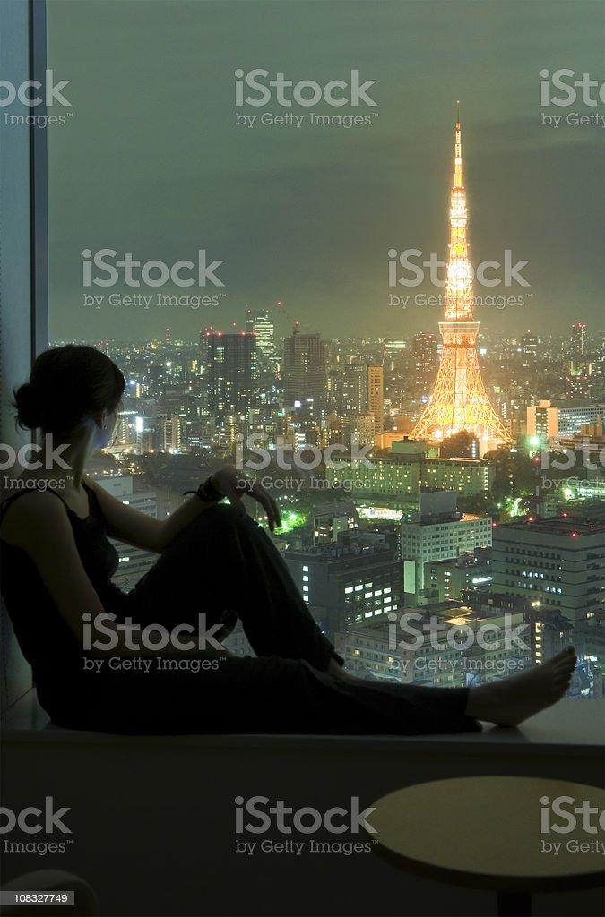 Young Woman Viewing Tokyo at Night royalty-free stock photo