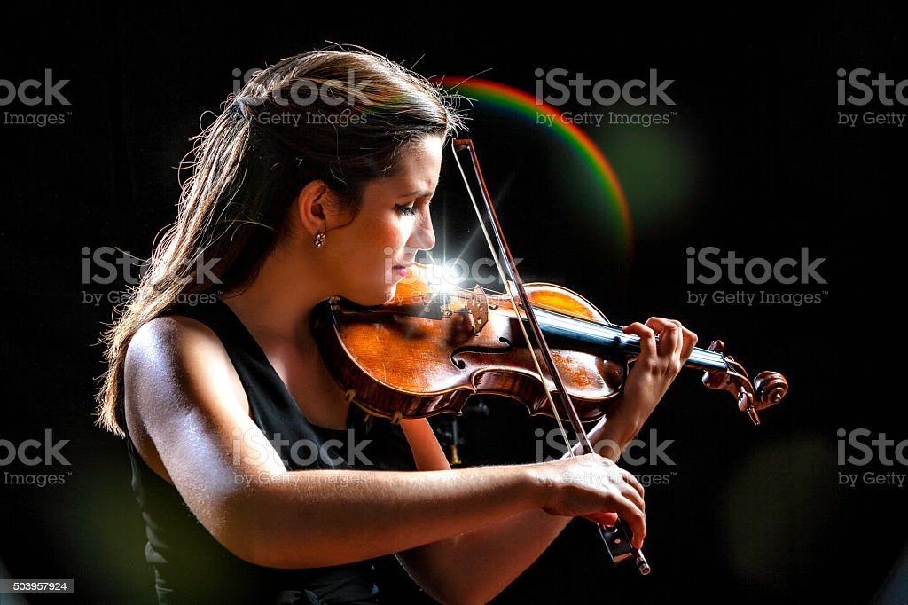 Young woman violinist player during presentation stock photo