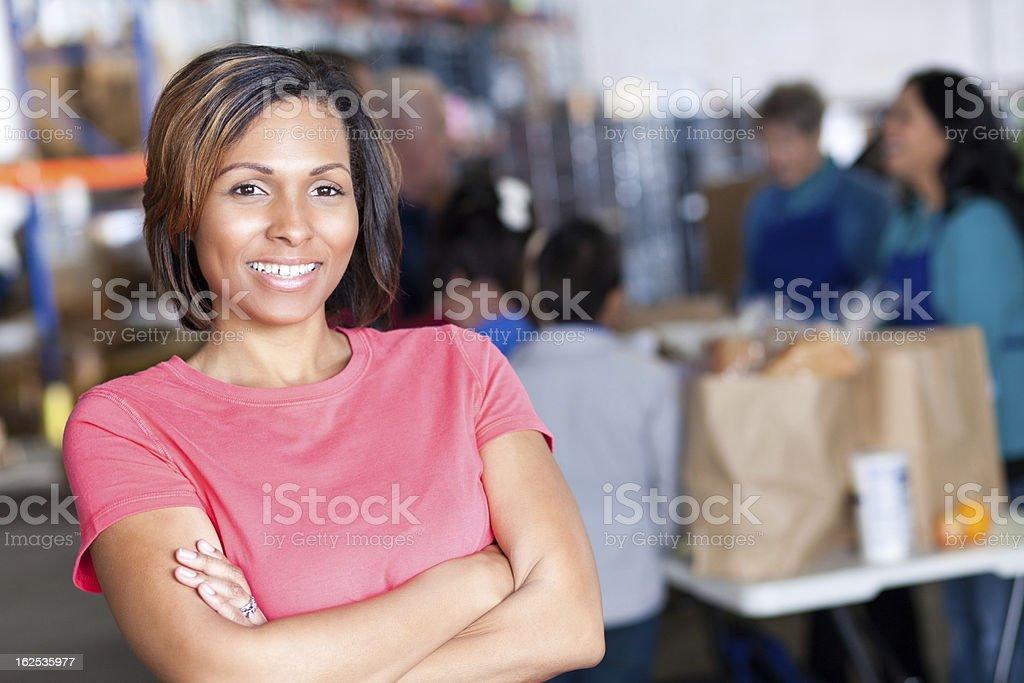 Young woman volunteer at a food bank facility royalty-free stock photo