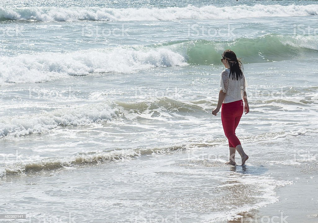 Young woman wading on Beach royalty-free stock photo