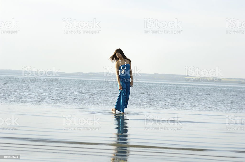 Young woman wading royalty-free stock photo