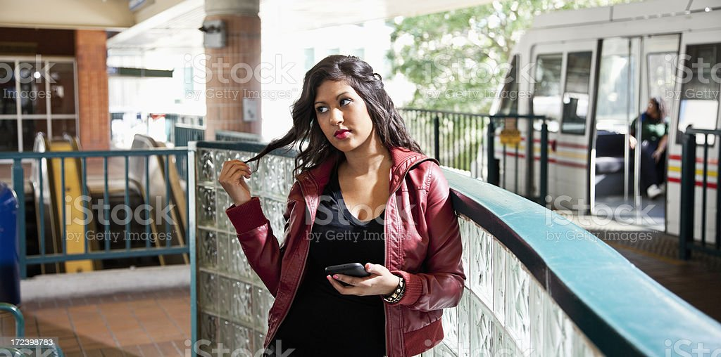 Young woman waiting at train station royalty-free stock photo