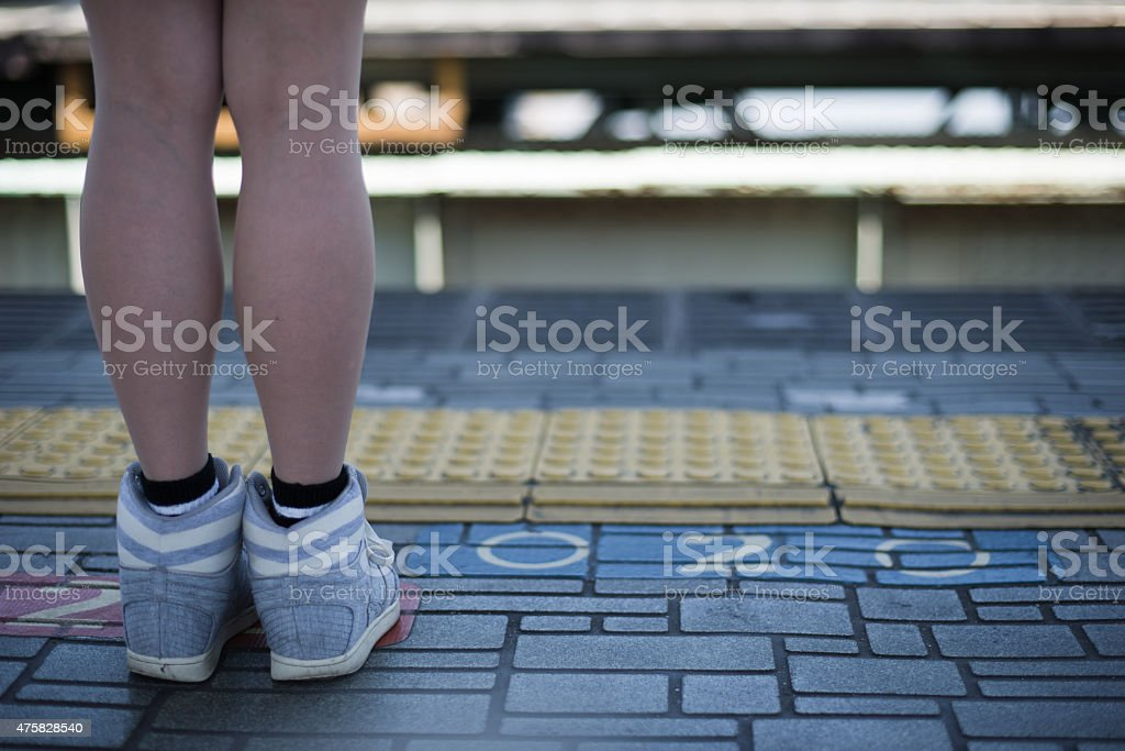Young woman waiting for a train stock photo