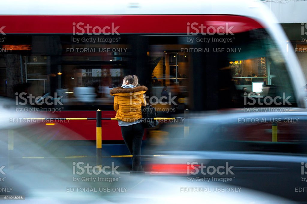 Young woman waiting for a tram stock photo