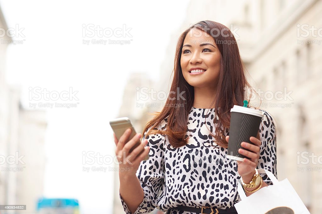 young woman waiting for her smartphone taxi stock photo