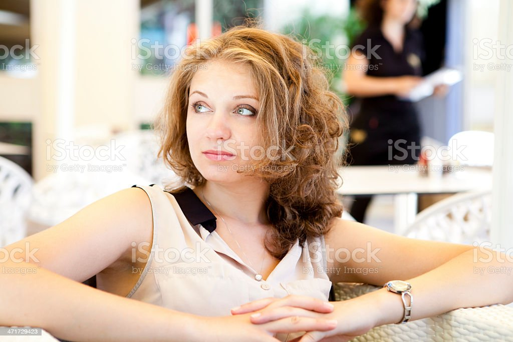 Young Woman Waiting For Order In Cafe royalty-free stock photo