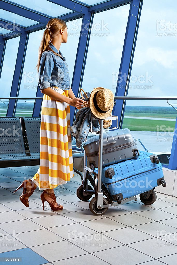 Young woman waiting for plane stock photo