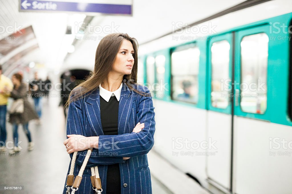 Young Woman Waiting For The Right Train In The Subway stock photo