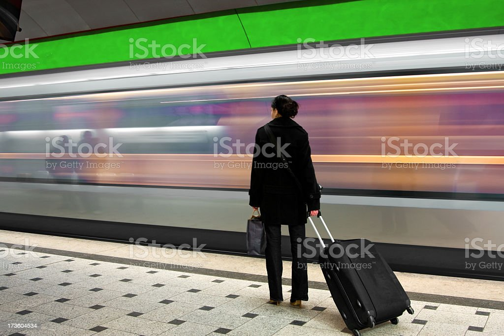 young woman waiting for the subway royalty-free stock photo
