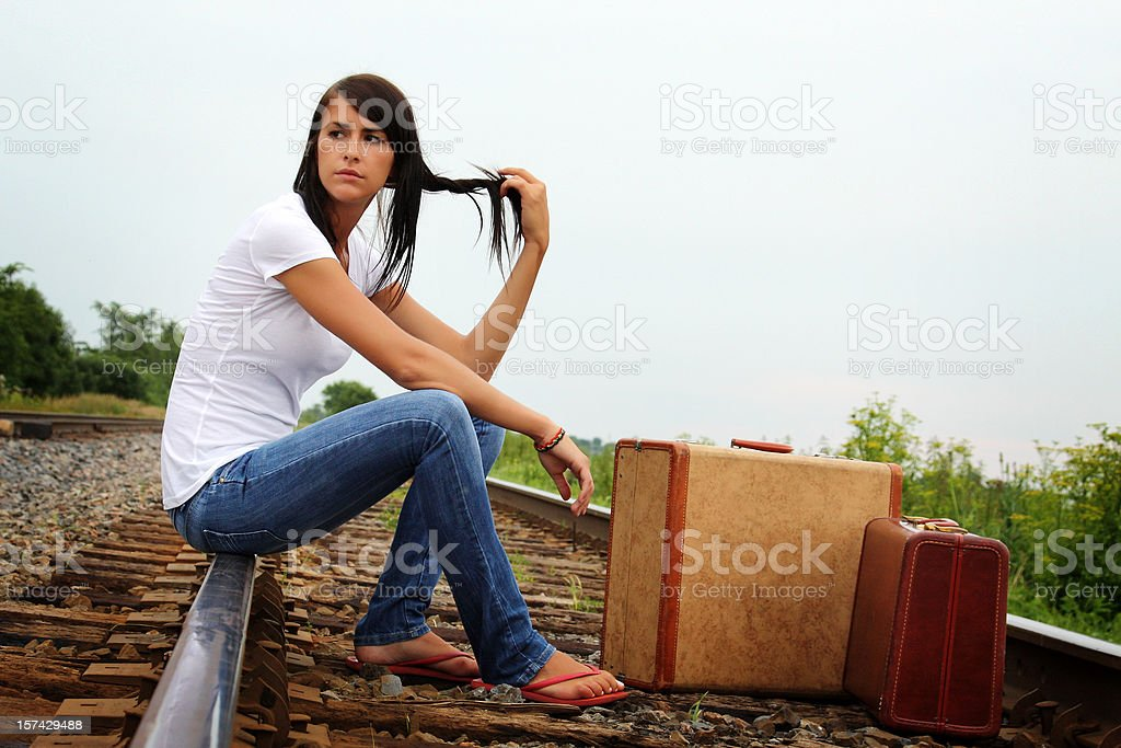 Young woman waiting for the train royalty-free stock photo