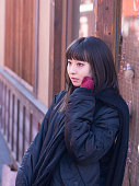 Young woman waiting in old Japanese town