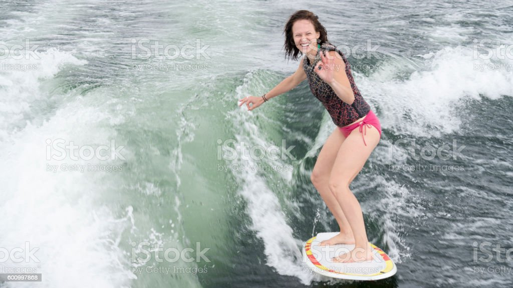 Young woman wakeboarding, wakesurfing stock photo