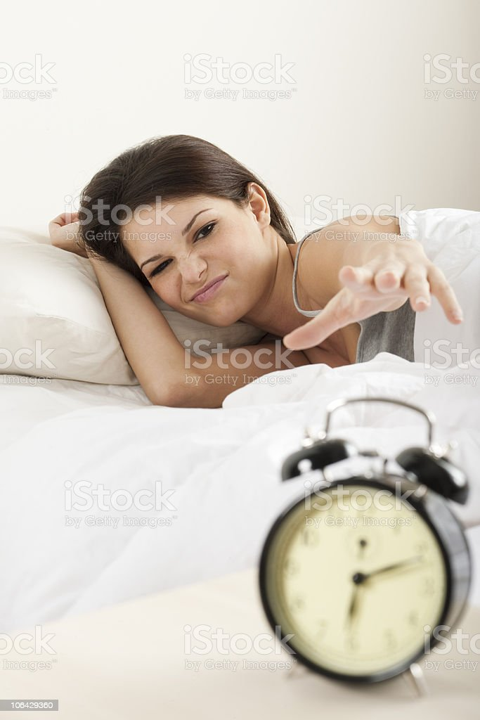 Young woman waking up royalty-free stock photo