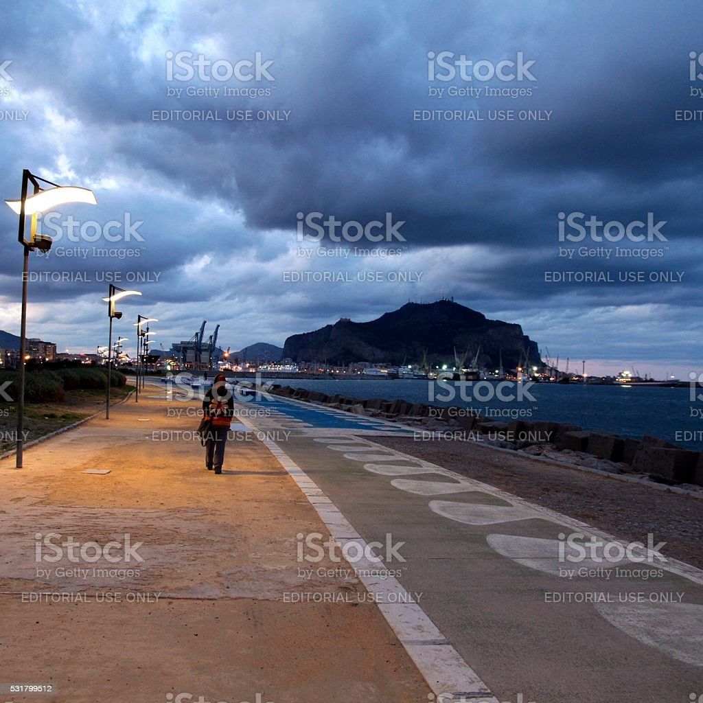 Young woman walking alone clouds in the sky Palermo stock photo