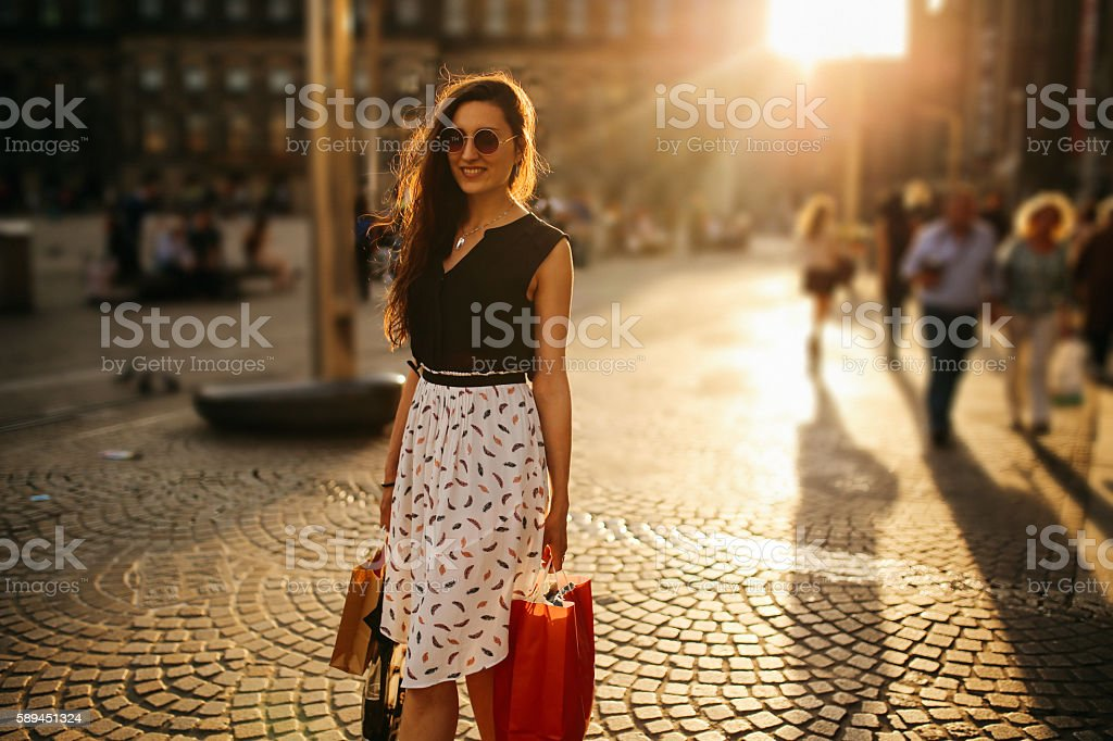 Young woman walking and shopping in Amsterdam stock photo