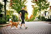 Young Woman Walking Dog