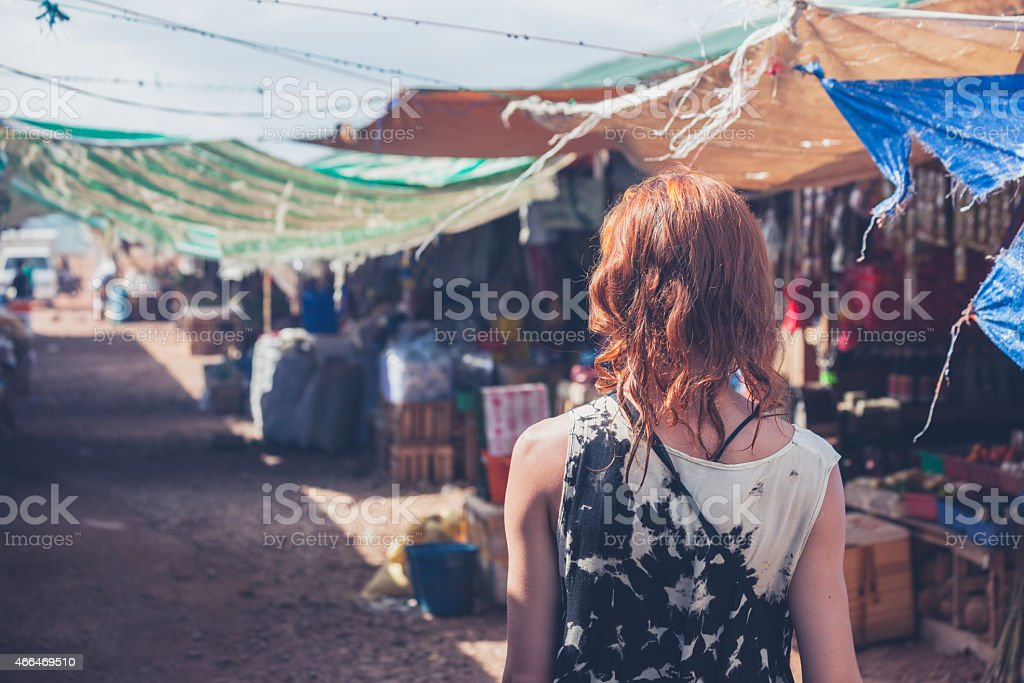 Young woman walking in a small town in developing country stock photo
