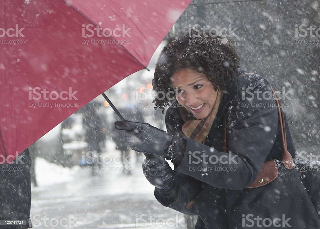 Young woman walking in a snow storm royalty-free stock photo