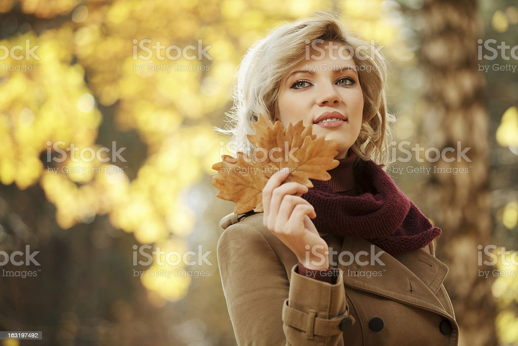 Young woman walking in autumn forest royalty-free stock photo