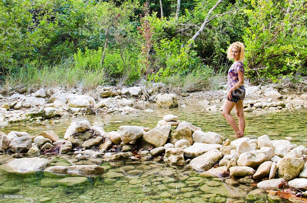 Young woman walking in Barton Creek Greenbelt in Austin, Texas stock photo